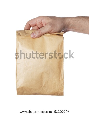 Man holding a brown paper bag in his hand. - stock photo