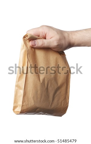 Man holding a brown paper bag with contents in his hand. - stock photo