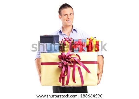 Man holding a bunch of presents isolated on white background - stock photo
