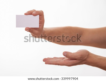 Man holding a business card and showing an empty palm