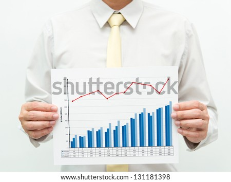 Man holding a business financial graph and chart - stock photo