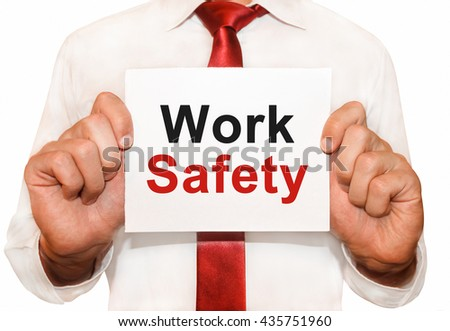 Man holding a card with a text Work Safety. - stock photo