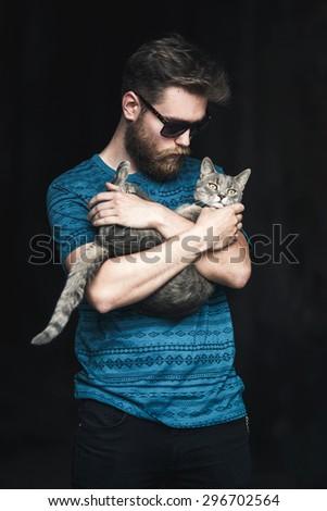 Man holding a cat, toned photo. - stock photo