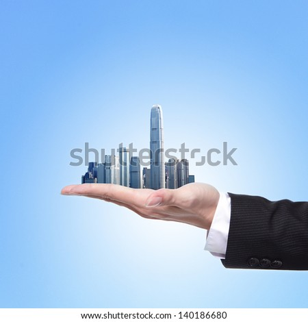 Man holding a city in hand, business concept - stock photo