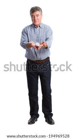 Man holding a die - stock photo