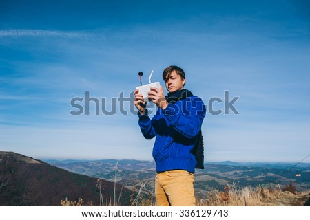 man holding a drone for aerial photography. silhouette against the sunset sky