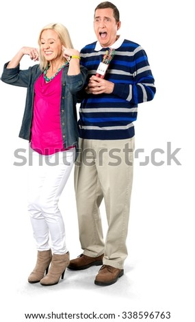 Man Holding a Dynamite and Woman Covering Ears - Isolated