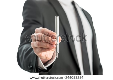 Man holding a fountain pen in his hand with the nib facing down in a communications concept, isolated over white background. - stock photo