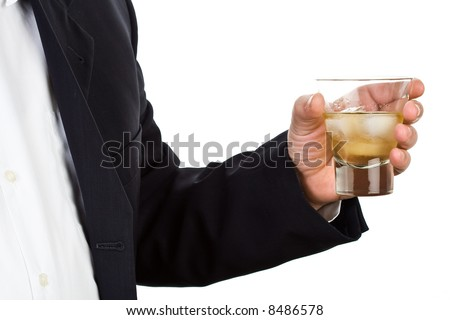 Man holding a glass of whiskey - stock photo