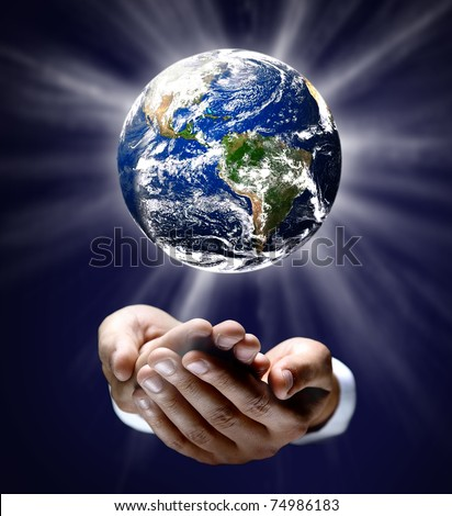 Man holding a glowing earth globe in his hands