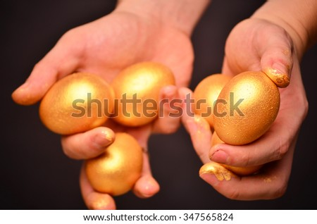 Man holding a golden eggs - investment concept