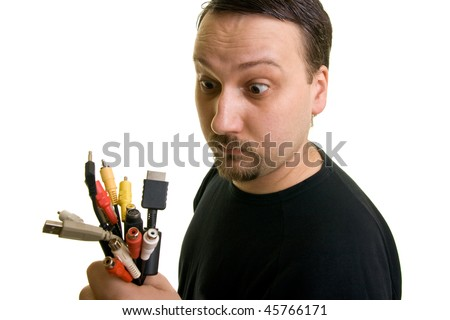 man holding a group of cables with anxious faces - stock photo