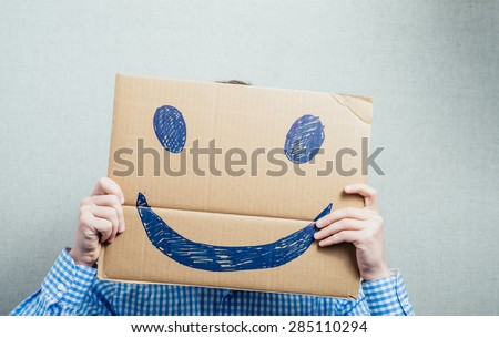 man holding a happy face - stock photo