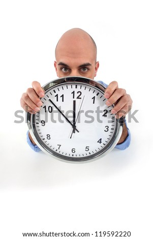 man holding a huge clock - stock photo