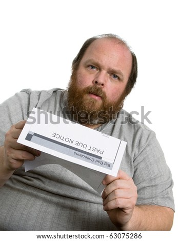 Man holding a past due notice and looking very worried - stock photo
