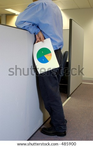 man holding a pie chart leaning over cubicle
