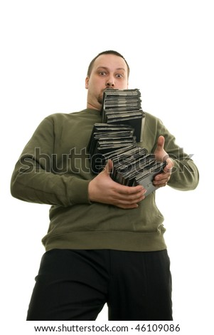 man holding a pile of CDs - stock photo