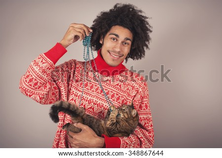 Man holding a red cat on his hands - stock photo