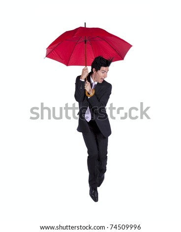 Man holding a red umbrella with fear (some motion blur) - stock photo