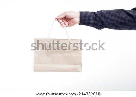 man holding a shopping bag on isolate background  - stock photo