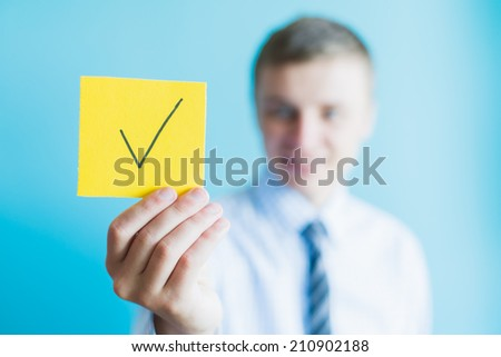 man holding a sign character and the icon for the approved concept design and web graphics. - stock photo