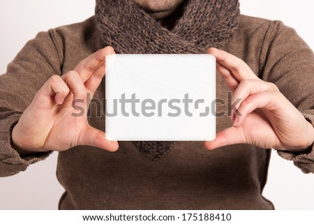 Man holding a sign for the label. Young man showing the place of words and writing in it. Close up of a businessman showing blank placard. Space for text. Isolated on white background. - stock photo