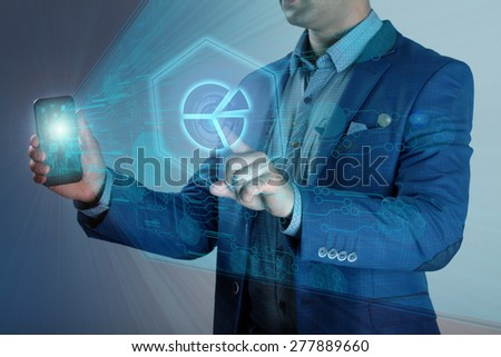 man holding a smartphone shows a virtual screen projection business schedule - stock photo