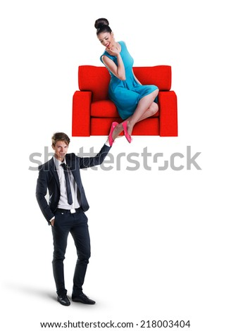 Man holding a sofa with woman sitting on it - stock photo