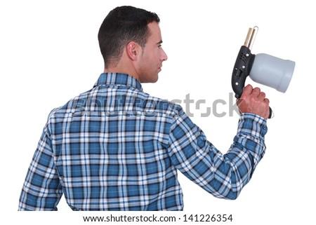 Man holding a spray gun - stock photo