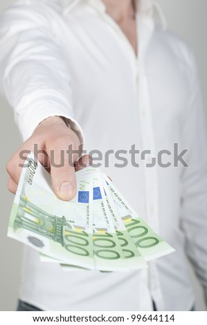 man holding a stack of cash in hand