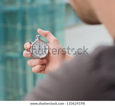 Man Holding A Stopwatch - stock photo