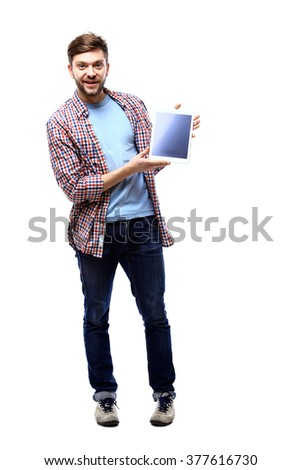 Man holding a tablet computer against a white background - stock photo