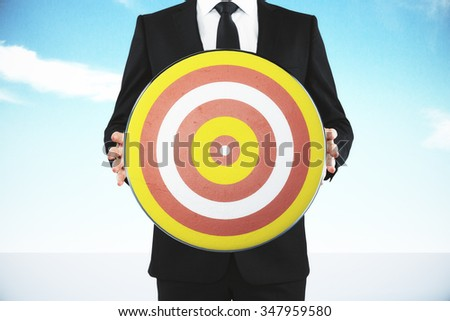 Man holding a target for darts - stock photo