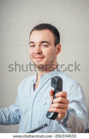 Man holding a telephone tube and smiling