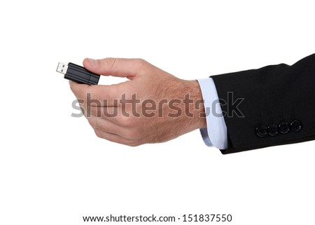 Man holding a USB key.