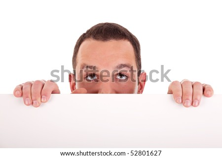 Man holding a white board, looking to camera, isolated on a white background. Studio shot. - stock photo