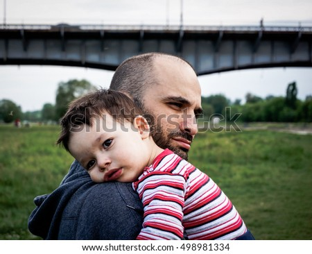 Man holding a young small boy