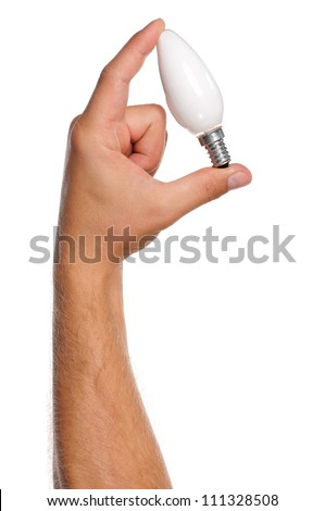 Man holding an small lightbulb isolated on white background - stock photo
