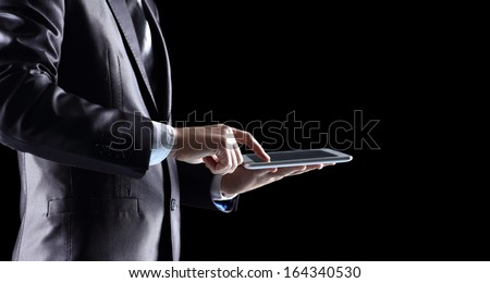 Man holding and touching digital tablet - stock photo