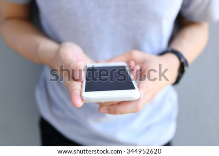 Man holding and use smartphone