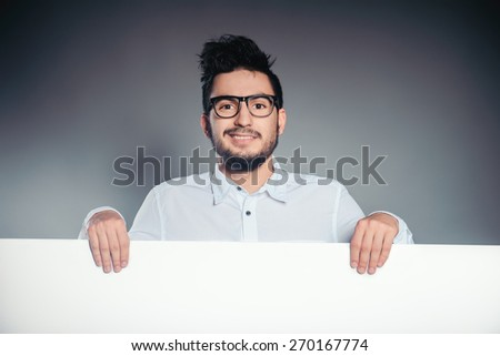 Man holding at whiteboard