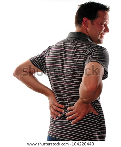 Man holding back because of lower back pain - stock photo