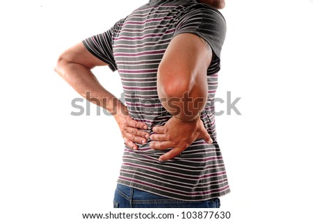Man holding back who is suffering from lower back pain - stock photo