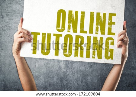 Man holding banner with ONLINE TUTORING title, conceptual image - stock photo