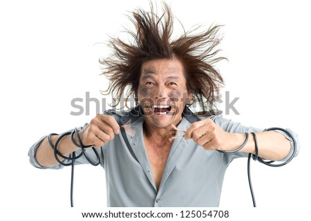 Man holding bared wires and screaming of pain - stock photo