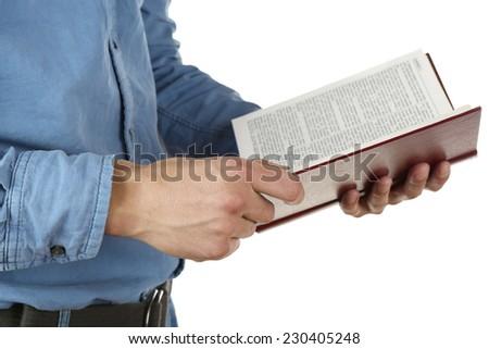 Man holding Bible isolated on white - stock photo