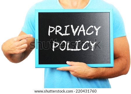 Man holding blackboard in hands and pointing the word PRIVACY POLICY - stock photo