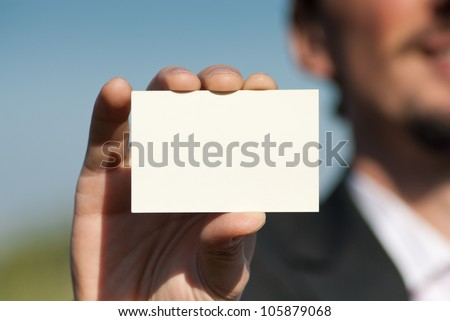 Man holding blank business card - stock photo