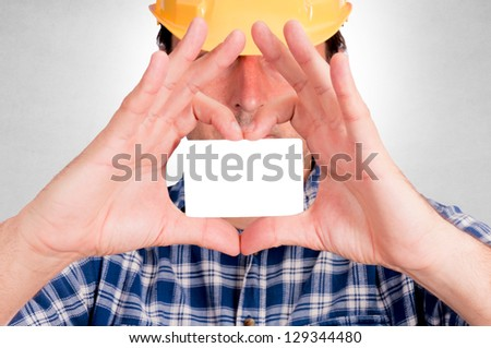 Man holding blank calling card - stock photo