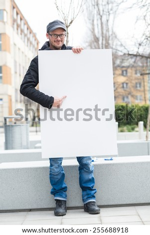 Man holding blank card  - stock photo